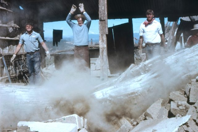 Elder Warnock (on the left) and Elder Larson (on the right) tear down damaged walls after the earthquake in Guatemala 1976