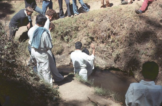 Elder Salazar baptizing Ricardo Cua in the river Balanyá on February 12, 1976