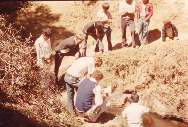 Elder Choc baptizing [ ] in the river Balanyá on February 12, 1976