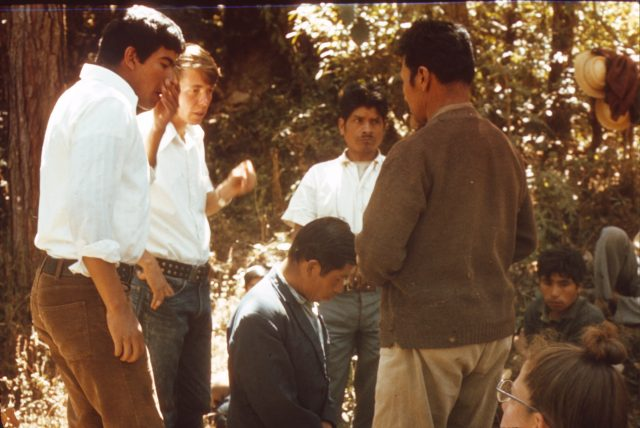 Elder Richman preparing to confirm Ricardo Cua a member of the Church on the banks of the river Balanyá on February 12, 1976.