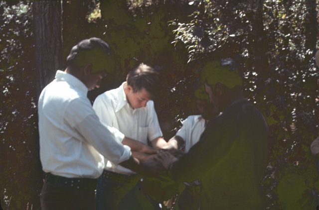 Elder Richman confirming Ricardo Cua a member of the Church on the banks of the river Balanyá on February 12, 1976.