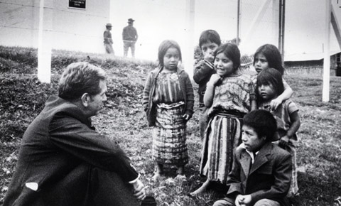 Elder Boyd K. Packer visits with children in Guatemala. This photo was taken in 1979 in an unidentified town. I was most likely at a chapel dedication, but not in Patzicia.