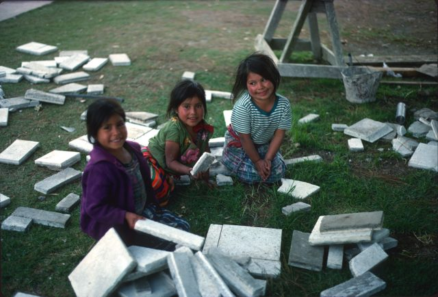 Children in Patzicía playing with construction materials at the rebuilding of the church in Patzicía in 1978