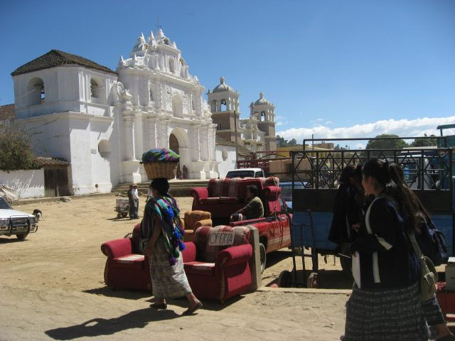 In 2009, showing the facade of the old Comalapa Catholic church rebuilt and a new church beside it.