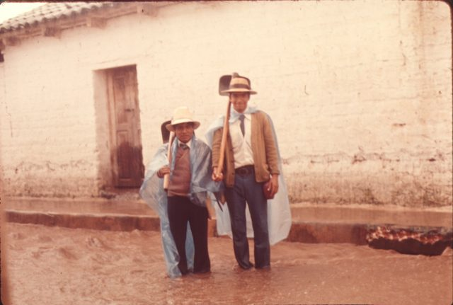 Elder Choc and Elder Salazar standing in the street after a heavy rain