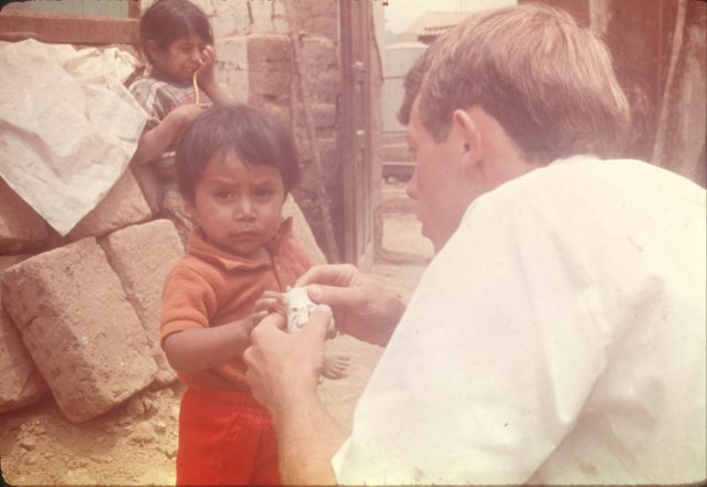 Elder Richman helping a child