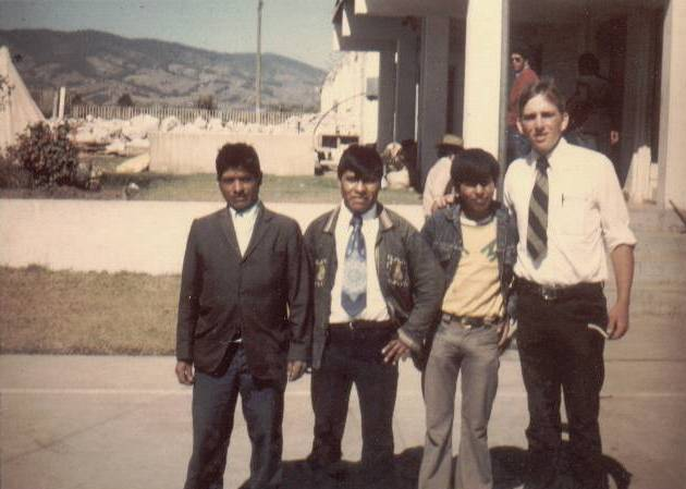 Branch president Pablo Choc, his sons Elder Daniel Choc and Austin Choc, and Elder David Frishknecht behind the fallen church in Patzicía after most of the rubble was removed.