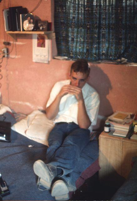 Elder David Frischknecht practicing the harmonica in the apartment in Patzicía