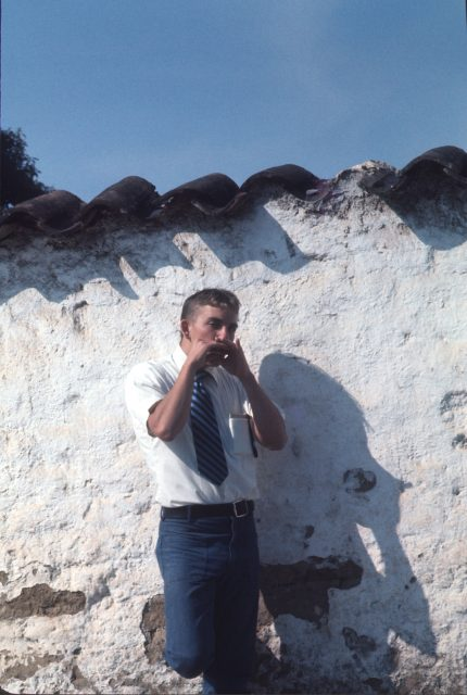 Elder David Frischknecht playing the harmonica in Patzicía