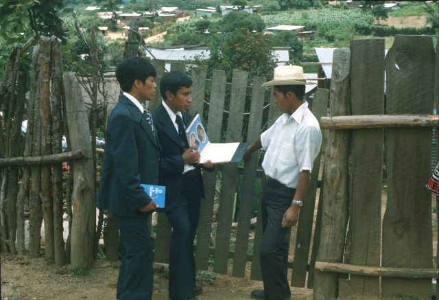 Missionaries at the door. (Photo I took for the missionary flipchart.)