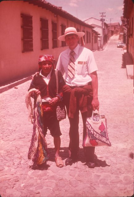 Elder Larson next to a man in Chichicastenango