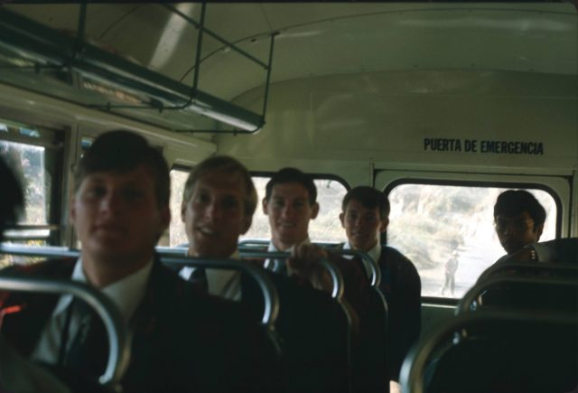 Missionaries on a bus: Elders Larson, Schmollinger, Bernhardt, Richman, Argueta