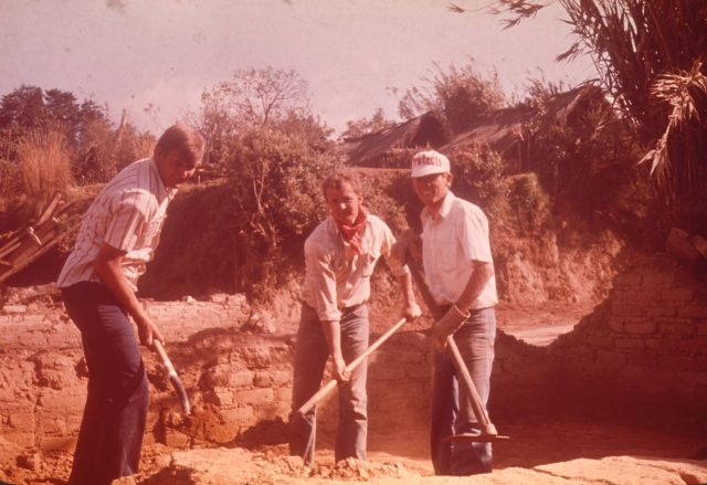 Mixing adobe mud, Elders Larson, Robbins, and Richman