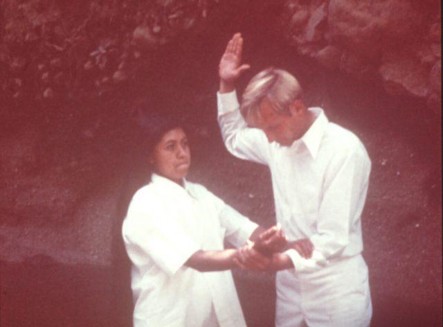 Elder Steven Schmolinger baptizing Maria Elena Miza