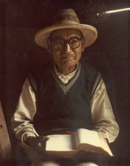 Cakchiquel man reading scriptures