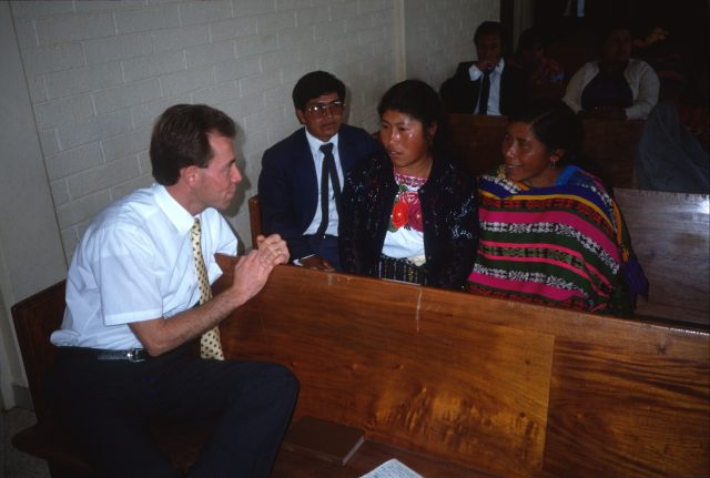 Elder Richman visiting with members in the chapel in Patzicía