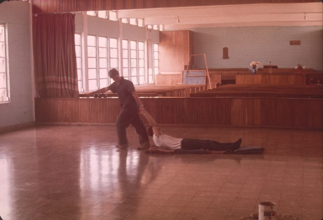 Elder Howard and Elder Richman buffing the tile floor