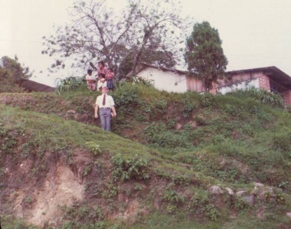 The house where the LDS missionaries lived in Sololá, with the housekeeper Tona and Elder Schawanvelt.