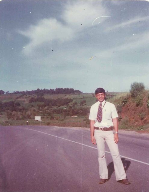 Elder Argueta on the highway waiting for a bus to Guatemala City