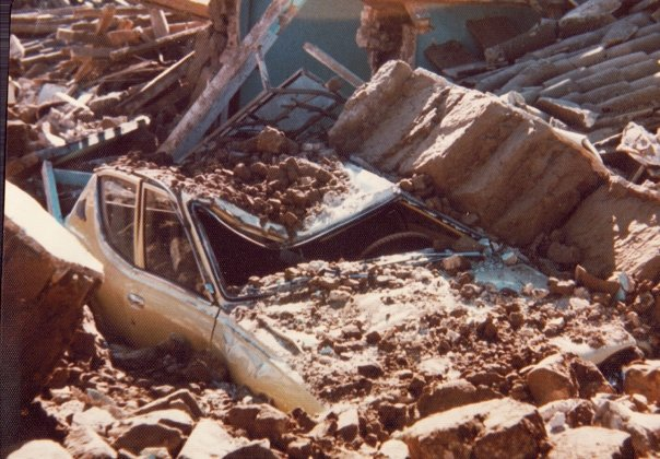 Car crushed by the weight of the adobe walls.