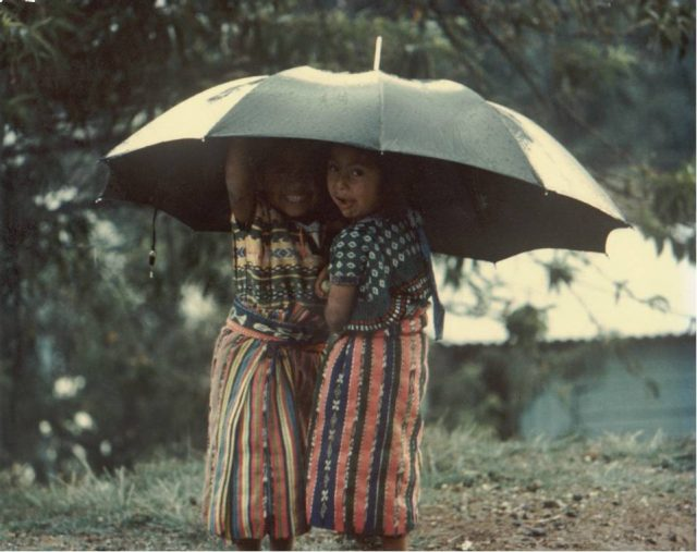Patzicía girls with umbrella