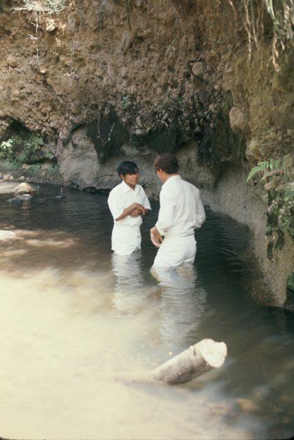 Elder Taz Evans baptizing Rigoberto Miza