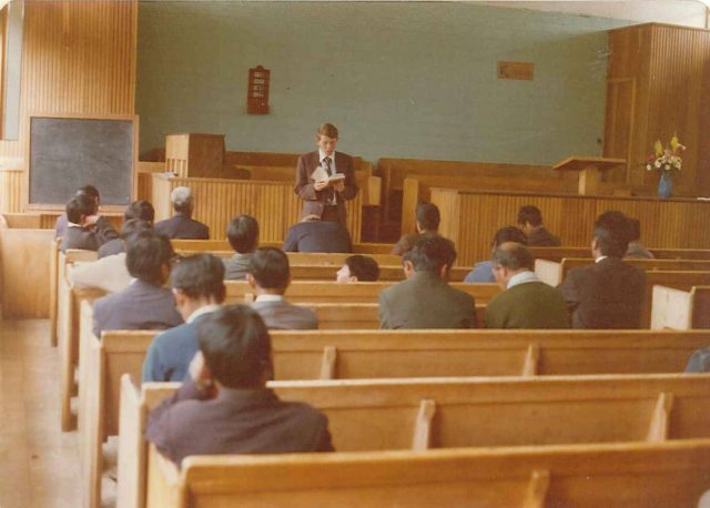 Elder Richman teaching priesthood meeting in Patzicía on September 7, 1975. Front row (left to right): Daniel Mich, Fidel Cujcuj, Pablo Choc. Second row (left to right): Clemente Alomzo Mich, Elder Nelson, Santiago, Alejandro Choc. Third row: unknown. Fourth row (left to right): unknown, Santiago Merén, unknown, Román Choc. Fifth row: Domingo Choc. Sixth row: Moises Choc, Ildefonso Simalij, unknown, Pedro Cujcuj, Domingo Choc. Seventh row: Gabino Mich. Eighth (back) row: Juventino Per Mich.