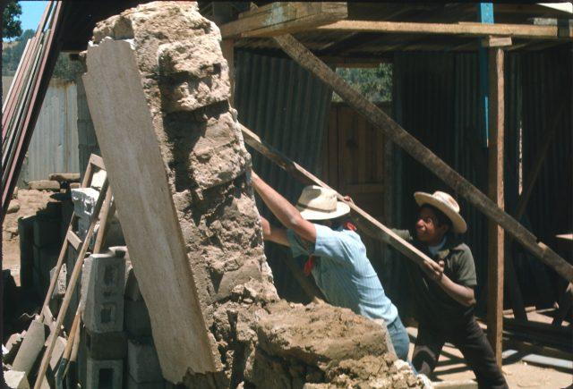 Elder Richman pushing over a wall